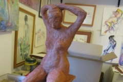 clay sculpture woman putting up her hair no.1