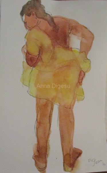 back view of yellow robed woman