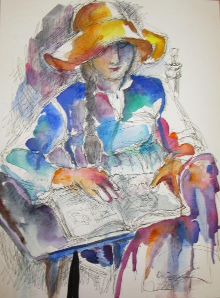 Woman in hat reading art book